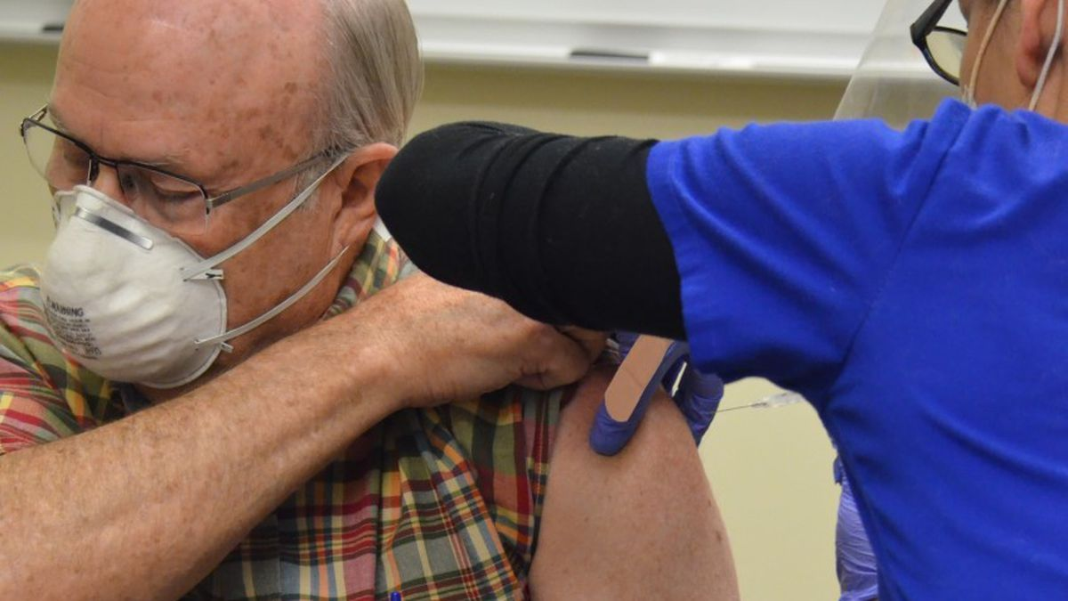 Philip Benning was the first person at Colorado Springs' VA clinic to receive the COVID-19...