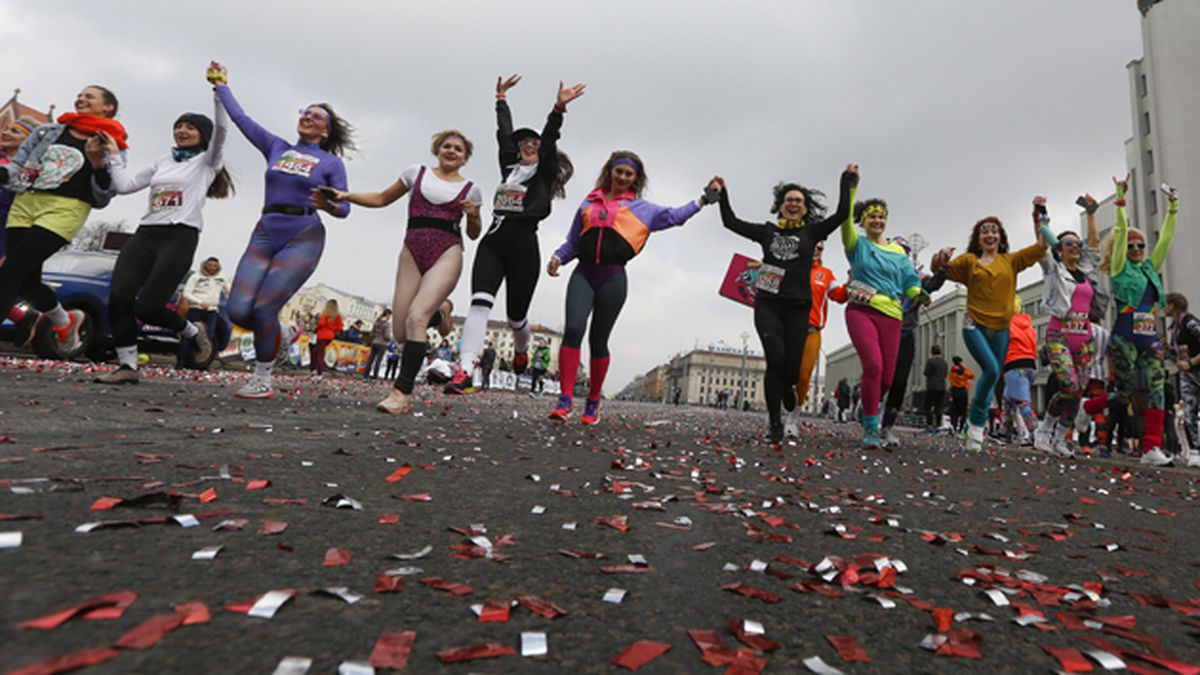 """Participants take part in the women's """"Beauty Run"""" in Minsk, Belarus, Sunday, March 8, 2020. Five-thousand participants took part in the event in connection with International Women's Day, which is an official holiday in Belarus. (AP Photo/Sergei Grits)"""