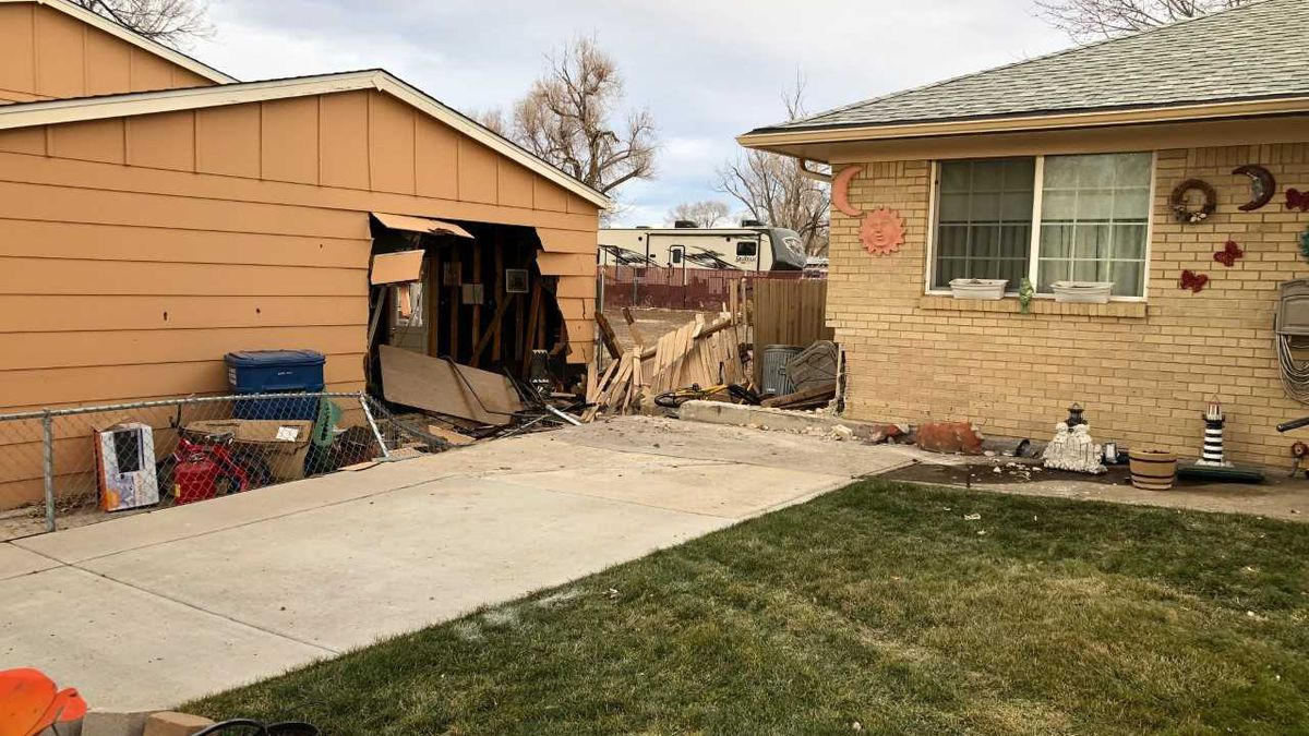 The driver took out the corner of one house, plowed through a chain-link fence into a neighboring garage, and ditched the truck.  When a tow truck got on scene, the pickup was still sticking out of a gaping hole in the side of the garage.