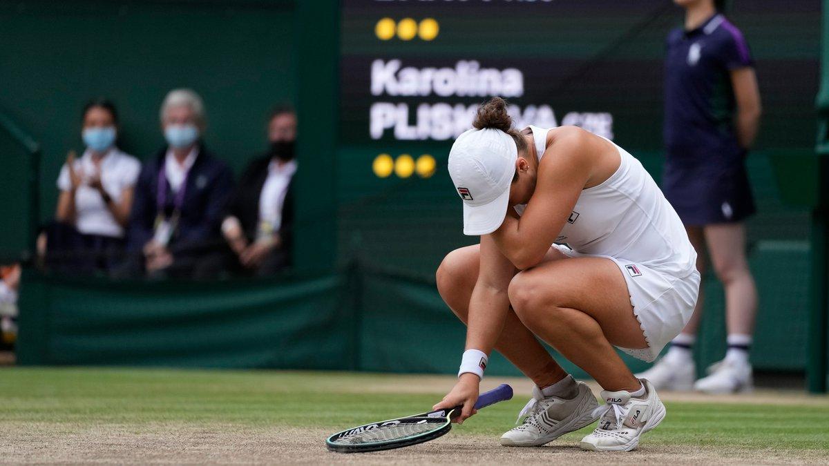 Australia's Ashleigh Barty reacts after defeating the Czech Republic's Karolina Pliskova in the...