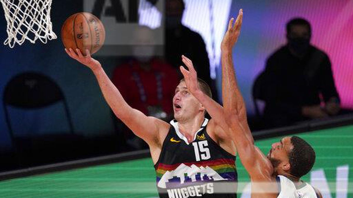 Denver Nuggets' Nikola Jokic (15) goes up for a shot as Utah Jazz's Rudy Gobert (27) defends during the second half an NBA first round playoff basketball game, Tuesday, Sept. 1,2020, in Lake Buena Vista, Fla.