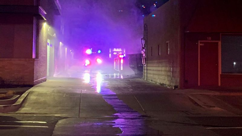 Firefighters responding to one of nearly a dozen fires set in dumpsters in downtown Colorado...
