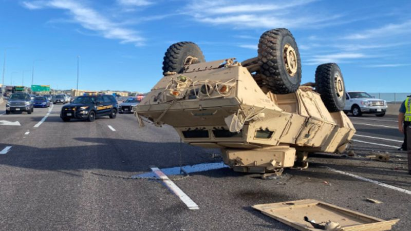 A military vehicle fell off a truck and landed upside down on a Colorado highway.