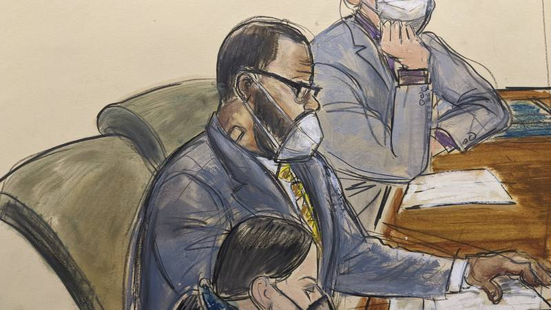 In this courtroom sketch, R. Kelly, center, sits with his defense attorneys Thomas Farinella,...