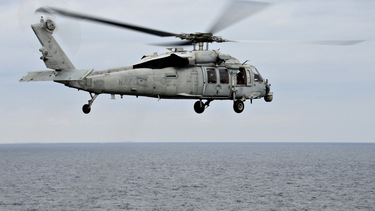 """An MH-60S Sea Hawk helicopter, assigned to the HSC-25 """"Island Knights""""  takes off from the..."""