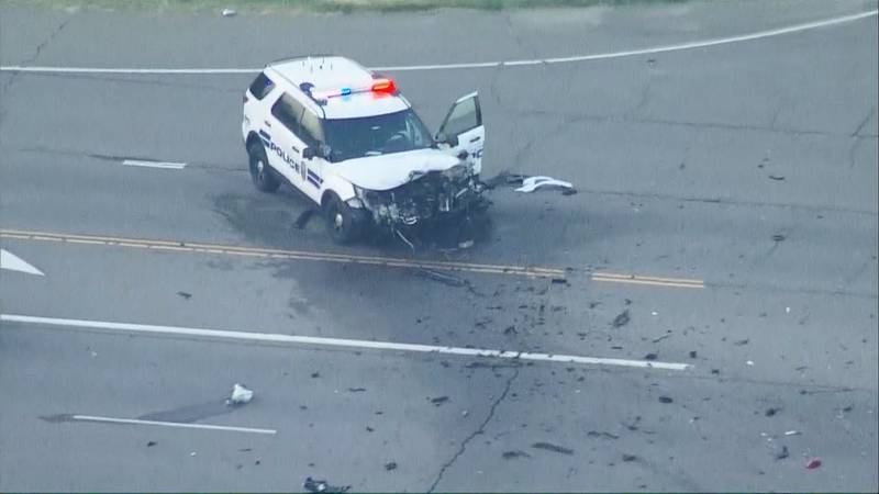 Police say an officer and two other people were hospitalized following a two-vehicle crash in...