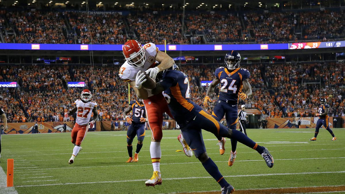 Kansas City Chiefs tight end Travis Kelce (87) is knocked out of bounds for an incomplete pass...