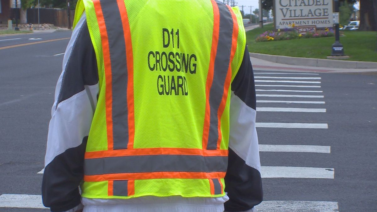 A D-11 crossing guard watches traffic at the corner of Chelton and Galley roads on the first day of school Wednesday, Aug. 14, 2019.