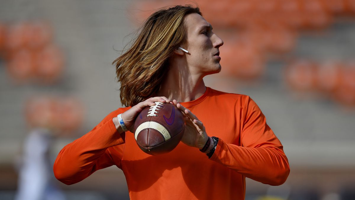 Clemson's QB Trevor Lawrence warms up. College football players from across the country united Sunday in an attempt to save their season and ensure they will no longer be left out of the sport's biggest decisions.