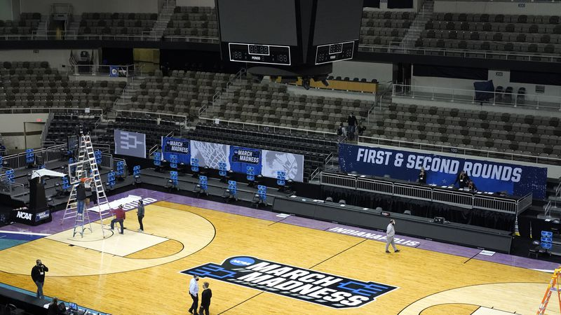 The Indiana Farmers Coliseum scoreboard goes dark after a first round NCAA college basketball...