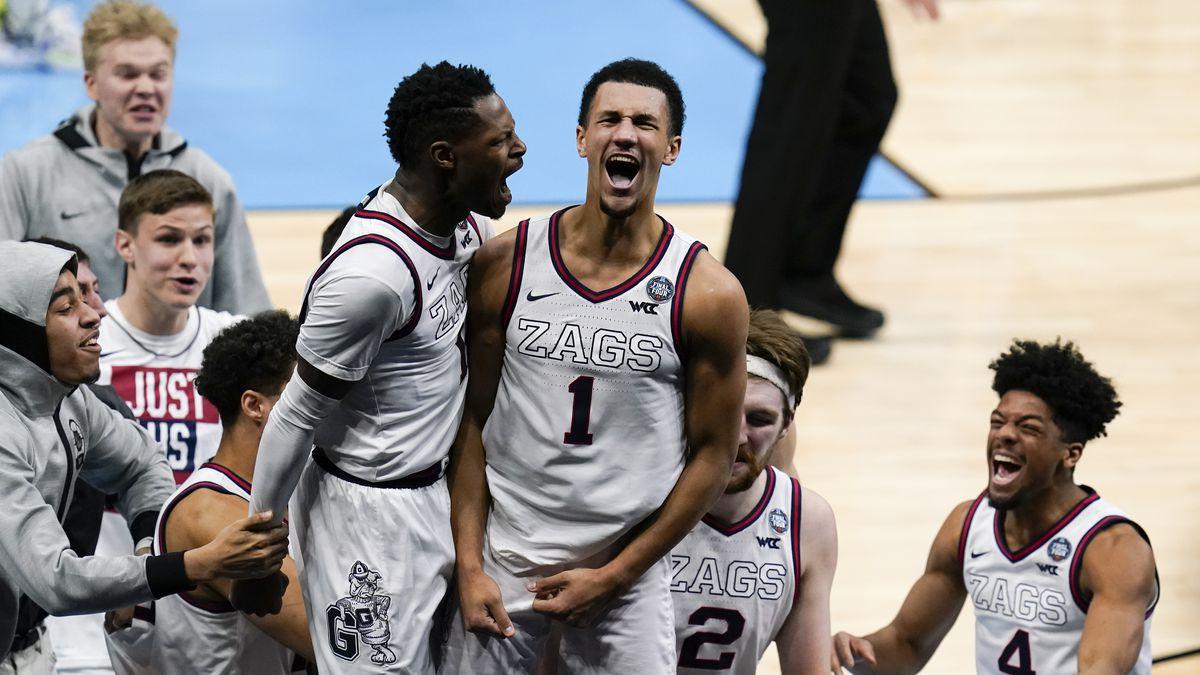 Gonzaga guard Jalen Suggs (1) celebrates making the game winning basket with Joel Ayayi, left,...